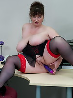 Huge breasted aged hooker playing in the office