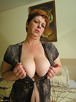Big titted elder bitch playing with her toys