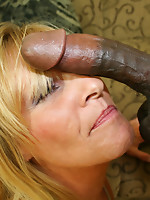 Lewd housewife munching on a big black cock